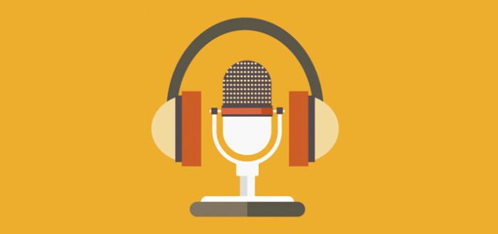 imagem ilustrativa mostrando um microfone no estilo antigo com um fone de ouvido no formato de arco sobre ele